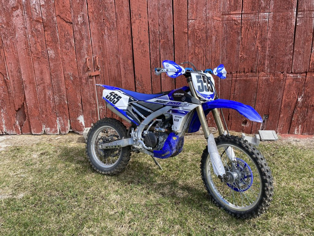 YZ250 in front of the barn